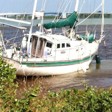 Sailboat aground needing marine survey and damage inspection