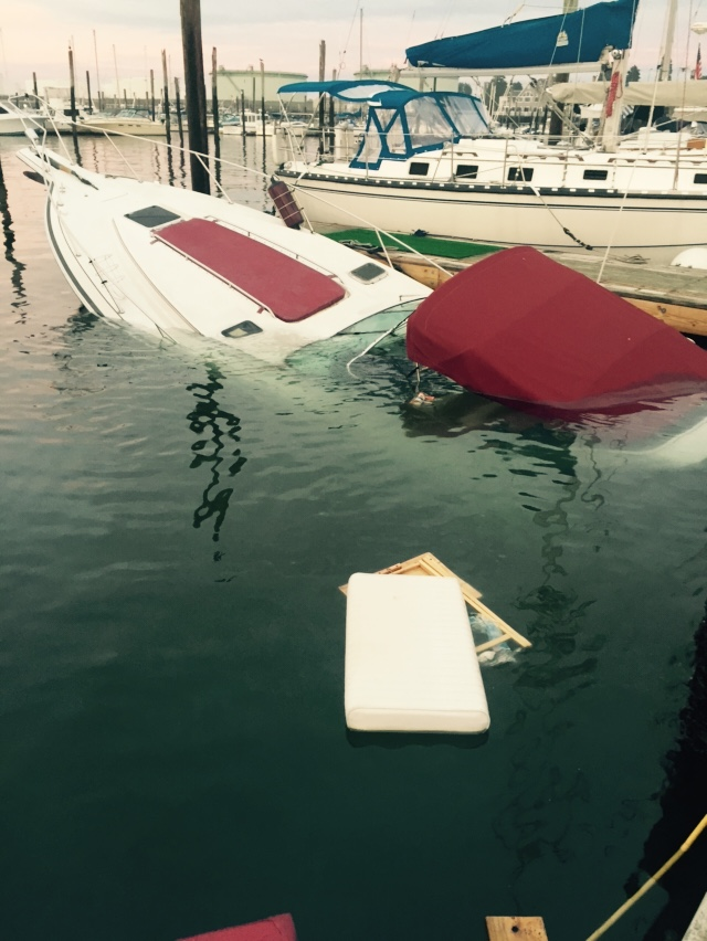 Sinking boat at the marina. Marine survey damage inspection required